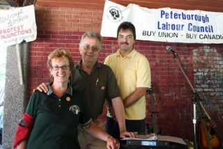 Marion Burton, President of the Peterborough and District Labour Council, front and Kevin Cassibo, rear
